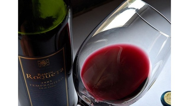 I'll drink to that! Study shows red wine helps shed pounds